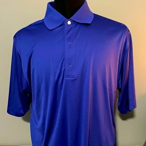 Men's NWT Greg Norman gently used golf shirt.